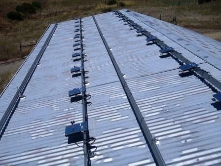 Corrugated metal roof prepared for install with Enphase micro-inverters