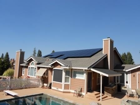 Flat tile roof solar power installation with all black modules