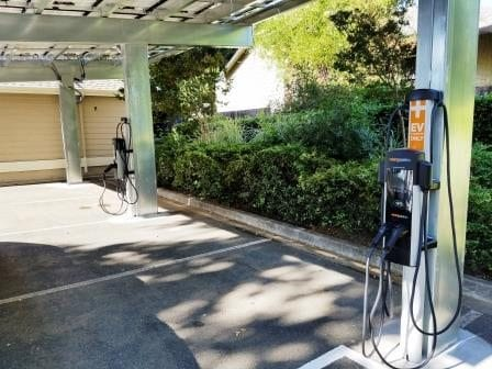 Car chargers: Level II EV Chargers mounted under solar system