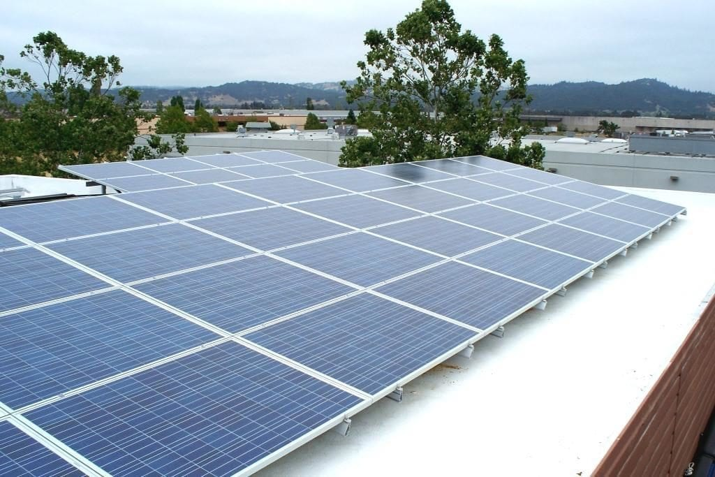 Commercial solar flat roof system with tilt arrays