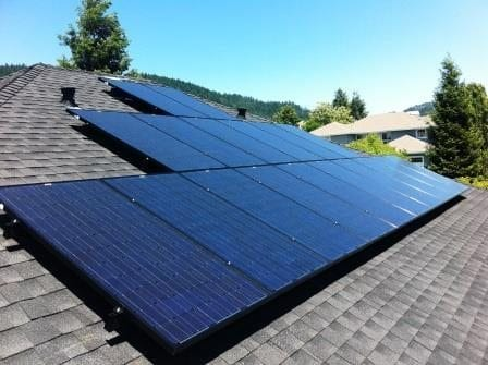 Comp roof installation with all black solar panel modules