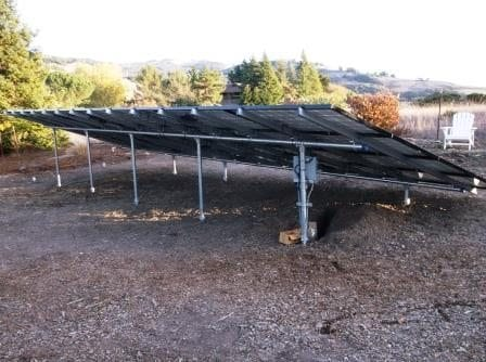 Ground mount solar panel system as seen from the rear during install