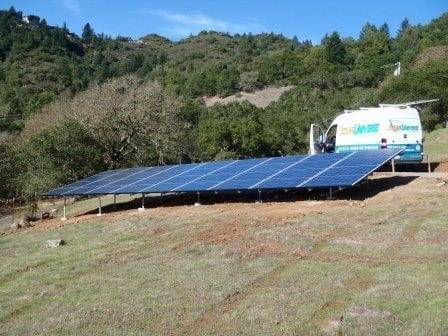 Ground mount solar panel array on hillside